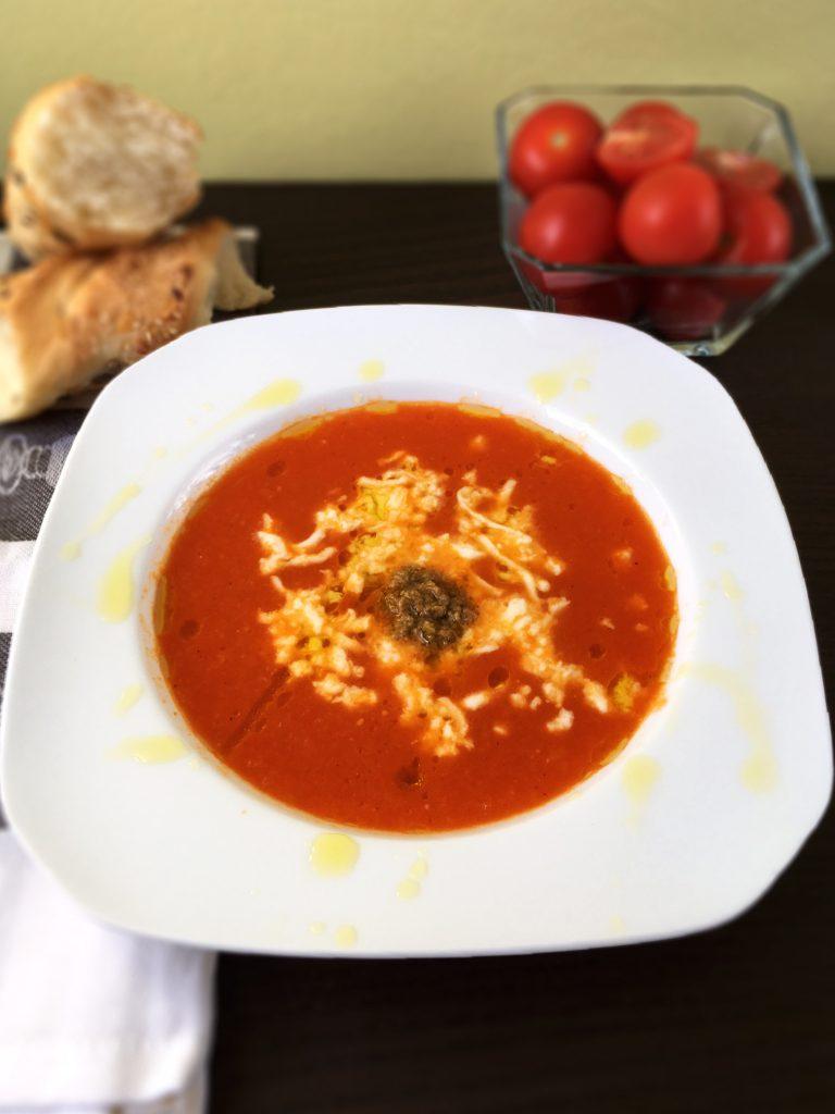 Tomato soup with mozzarella and pesto