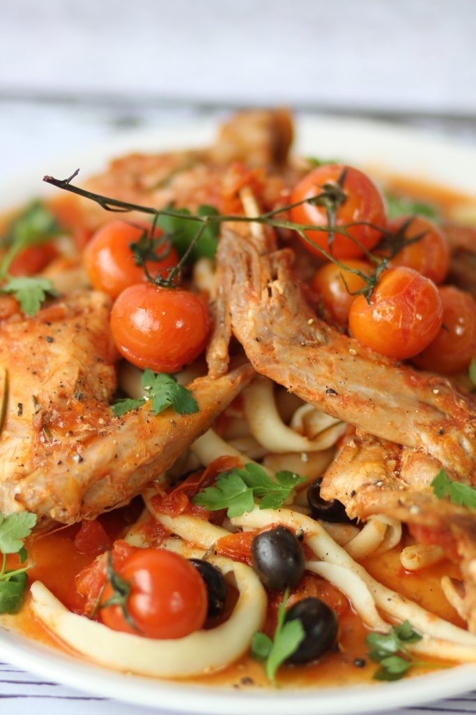 Basque-style rabbit with olives and pasta