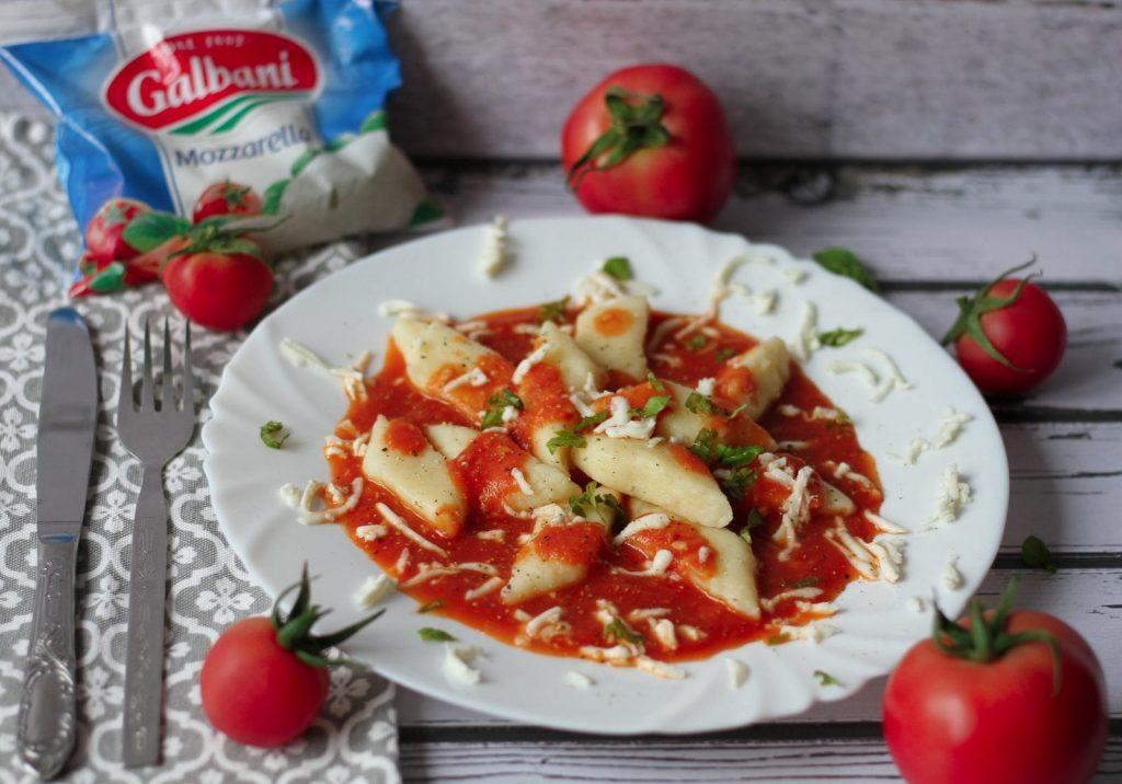 Gluten/free potato dumplings with tomato sauce