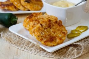 Cauliflower fritters with cheddar cheese sauce