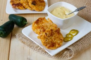 Cauliflower fritters with cheese sauce and jalapenos