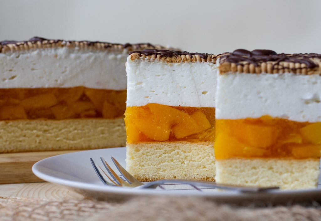 Peach cake with whipped cream