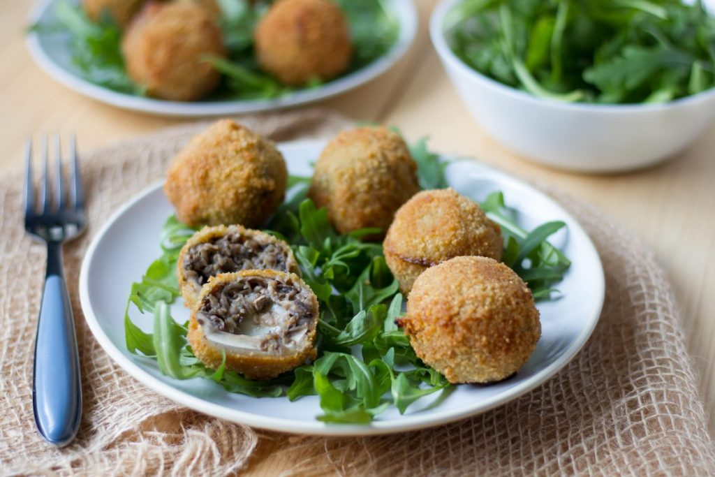 Deep-fried mushrooms stuffed with mozzarella