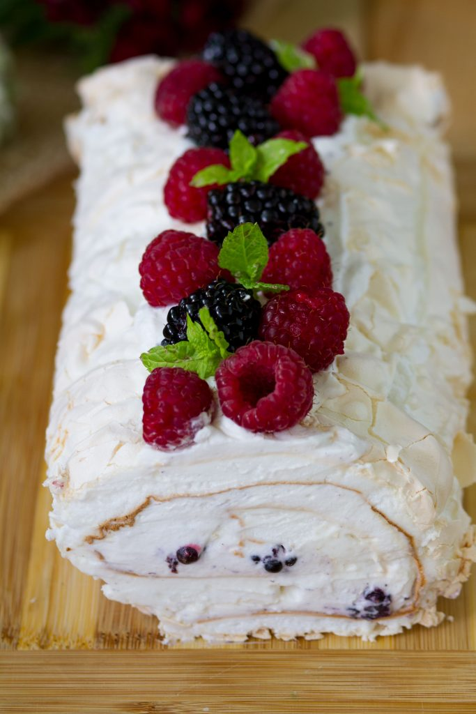 Meringue roulade with cream and fruits
