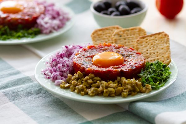 Tartare from tomatoes, peppers and eggplant
